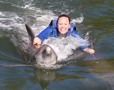 Dolphin towing a woman